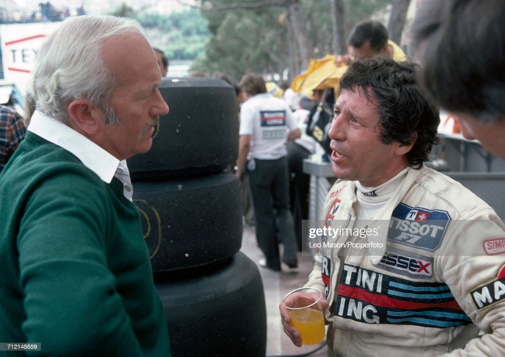 Formula One driver Mario Andretti of the United States and Colin Chapman, founder of Lotus Cars, pictured talking together at the Monaco Grand Prix in Monte Carlo on 27th May 1979. Andretti would drive a Lotus 80 with a Ford V8 engine for Martini Racing Team Lotus and retired from the race during the 21st lap due to suspension problems.