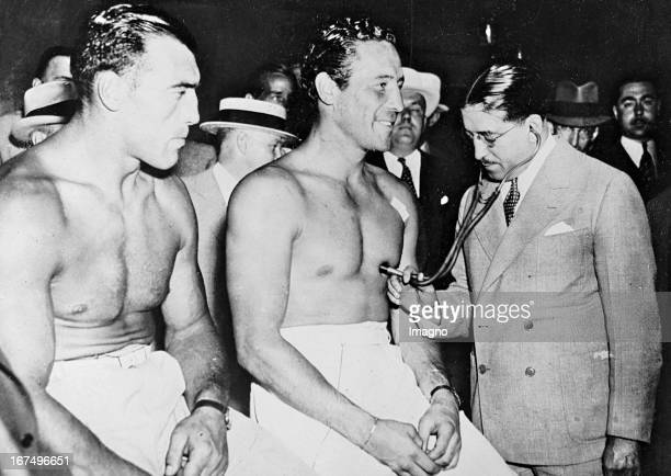 Italian boxer and 1933/34 world heavyweight champion Primo Carnera with the USamerican heavyweight boxing champion Max Baer at the medical...