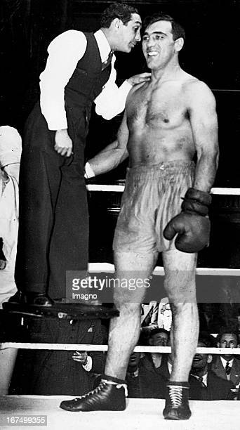 Italian Boxer Primo Carnera after a more than a yearlong break with his coach Benny Goodman at a training in London 15th October 1937 Photograph Der...