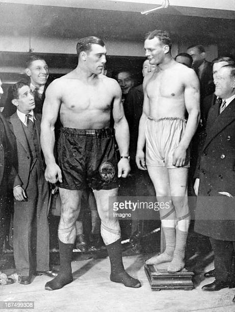 Italian Boxer Primo Carnera with the British boxer Reggie Meen when weighing before their fight at the Royal Albert Hall in London 18th December 1930...