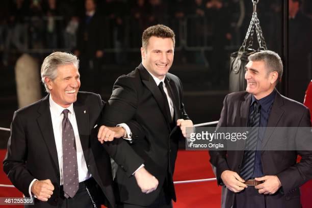 Italian boxers Nino Benvenuti Roberto Cammarelle and Patrizio Oliva attend the 'Grudge Match' Rome Premiere on January 7 2014 in Rome Italy