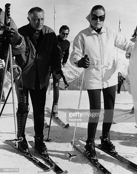 Italian businessman Gianni Agnelli President of Fiat skiing in St Moritz Switzerland with Doris Kleiner the wife of actor Yul Brynner 1968