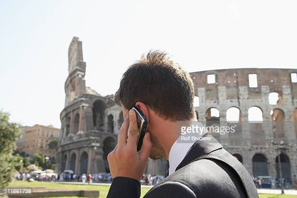 Italian businessman talking on cell phone outdoors