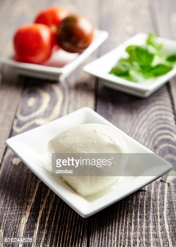 Italian caprese, mozzarella, tomatoes, basil : Stock Photo