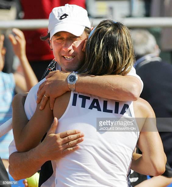 Italian captain Corrado Barazzutti congratulates Francesca Schiavone after her victory over Russian Dinara Safina 23 April 2005 in Brindisi during...