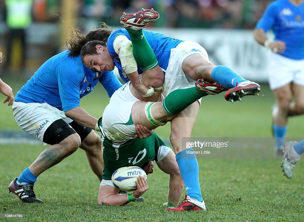 Italian Captain Sergio Parisse tackles Sean O'Brien of Ireland during the RBS 6 Nations Championships match between Italy and Ireland at Stadio...