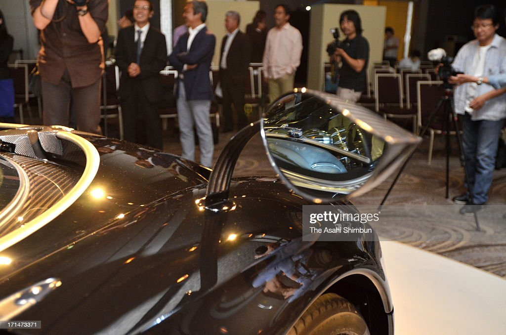 Italian car maker Pagani's supercar 'Hyuayra' (side mirror details) is displayed at its reveiling on June 24, 2013 in Tokyo, Japan. Pagani, founded by former Lamborghini designer Horacio Pagani in 1991, have produced order-made supercars.