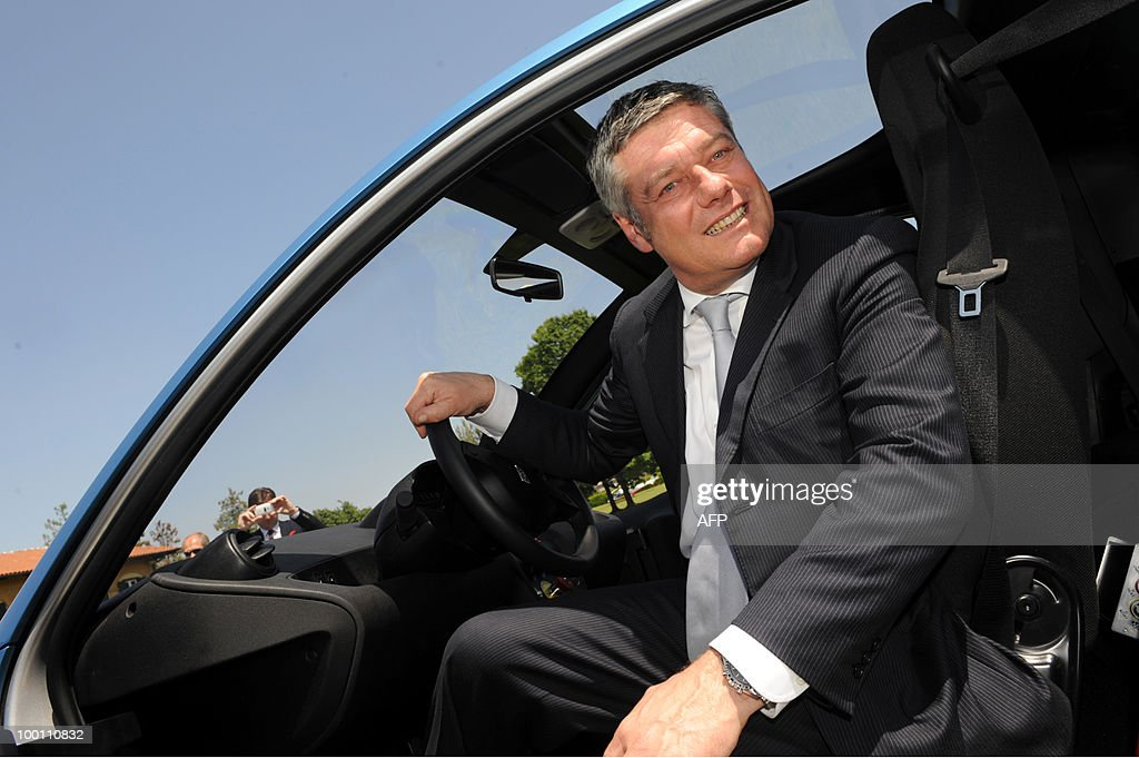 Italian car maker Pininfarina President Paolo Pininfarina sits in the new electric car 'Nido' as part of the 80th anniversary celebrations of Pininfarina group in Cambiano near Turin on May 21, 2010.