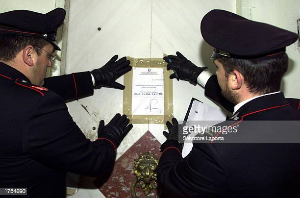 Italian carabinieres seal the door of the apartment where 28 Pakistani were arrested January 31 2003 in Naples Italy Large quantities of explosives...