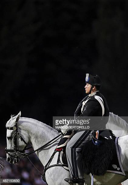 Italian Carabinieri knights from the military police perform the traditional 'Carousel' during a military parade marking the 200th anniversary of the...