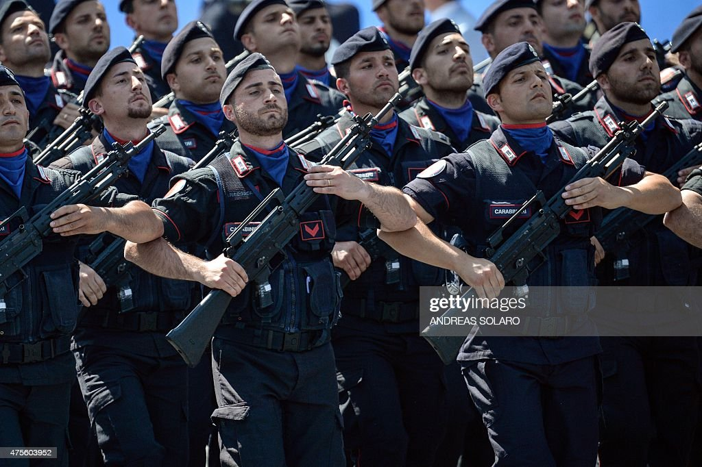 Italian carabinieri march on Via dei Fori Imperiali in central Rome on June 2 during the military parade as part of celebrations marking Italy's...