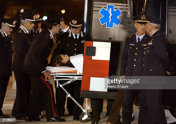Italian Carabinieri Marilena Iacobini one of the Italians wounded in a bomb attack in the southern Iraqi town of Nasiriyah is greeted by officials as...