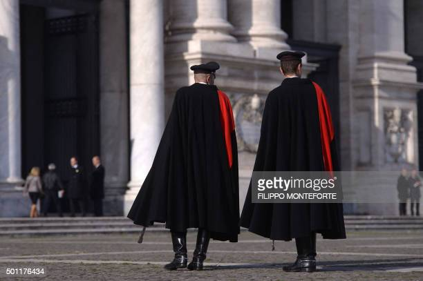 Italian carabinieri patrol outside St John in Lateran basilica where Pope Francis opens a 'Holy Door' today on December 13 2015 at the Vatican From a...