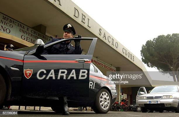 Italian Carabinieri police officers get in their vehicles outside Gemelli hospital February 24 2005 in Rome Italy Pope John Paul II was taken back to...