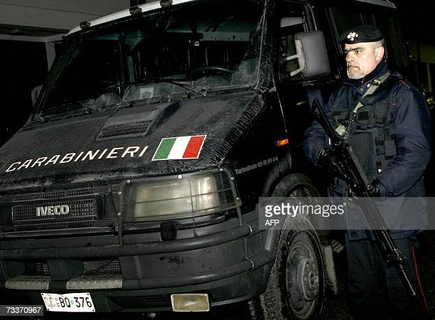 Italian carabinieri soldiers members of the NATO mission in Bosnia secure the perimeter during a raid in which they surounded and searched the...
