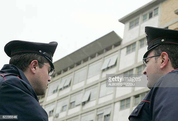 Italian carabinieri stand 24 February 2005 in front the Policlinico Gemelli Hospital in Rome where the Pope John Paul ll was hospitalized earlier in...