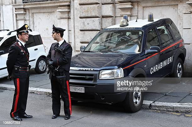 Italian Carabinieri stand in front of Palazzo Grazioli the Roman residence of Italian Prime Minister Silvio Berlusconi on November 13 201 AFP PHOTO /...