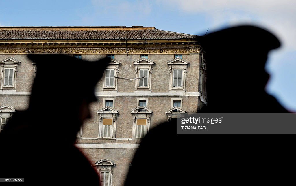 Italian Carabinieri stand in front of the Pope's apartment windows at St Peter's Square on the first Sunday without Angelus prayer in the Vatican City on March 3, 2013. Cardinals from around the world were summoned to meetings that will set a date for a conclave to elect a new pope, as Benedict XVI settled into a pensioner's life after becoming the first pontiff to resign in more than 700 years.