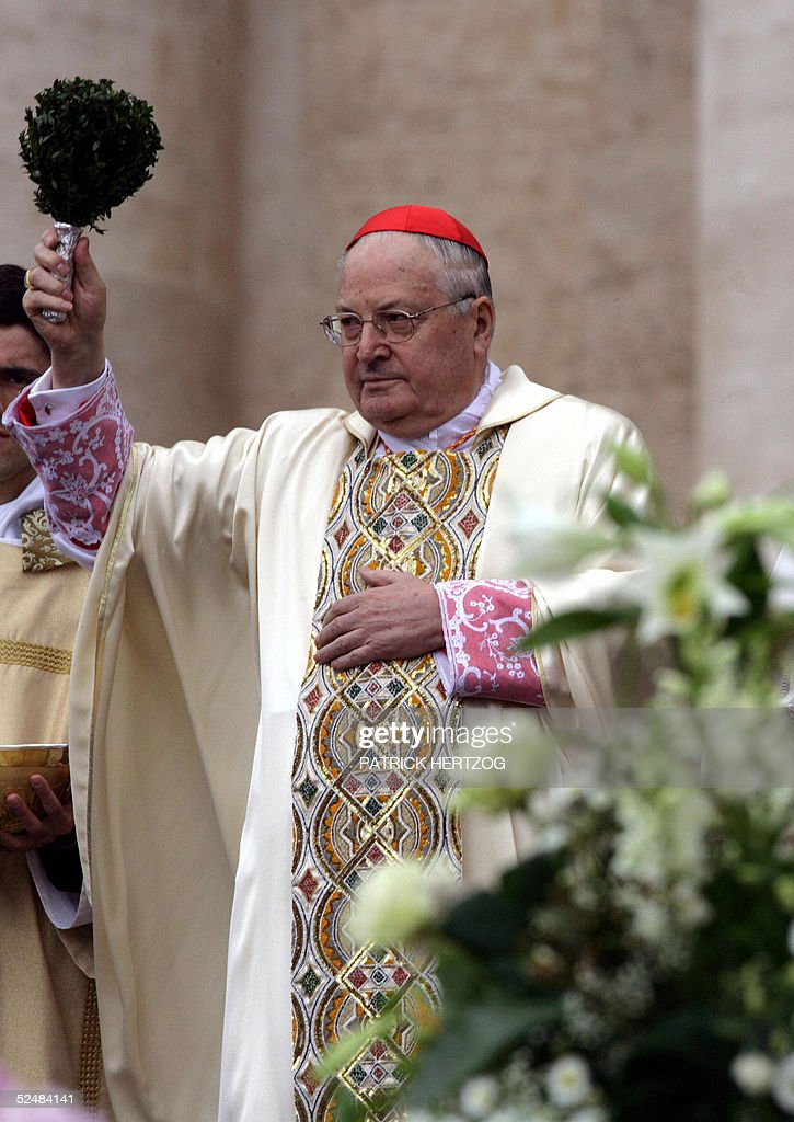 Italian Cardinal Angelo Sodano blesses the pilgrims gathered in St-Peter's square at the Vatican, during the Easter mass, 27 March 2005. For the first time since becoming pope 27 years ago, illness forced an ailing Pope John Paul II to miss Christianity's most important annual celebration, but tens of thousands of pilgrims flocked to the Vatican in the hope he would make a fleeting appearance after Easter Sunday mass. AFP PHOTO/ Patrick HERTZOG