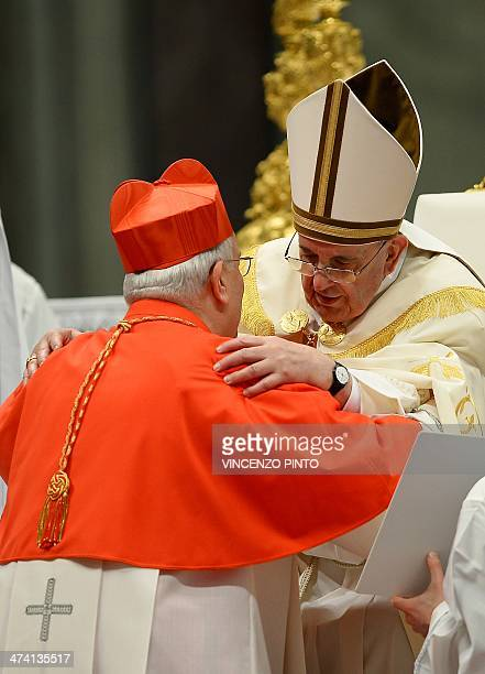 Italian cardinal Gualtiero Bassetti receives his beret as he is appointed cardinal by Pope Francis during a consistory in the Saint Peter's basilica...