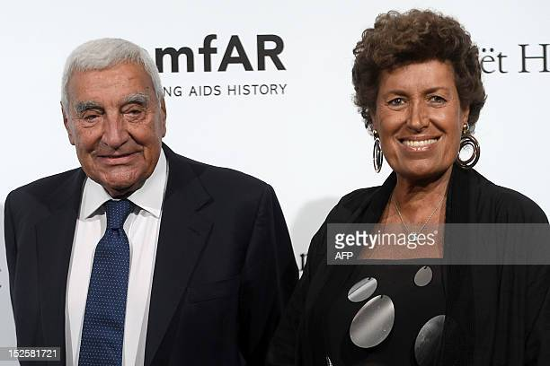 Italian Carla Fendi and her husband pose upon arrival for the fourth annual benefit for AIDS research of the amfAR on September 22 2012 during the...
