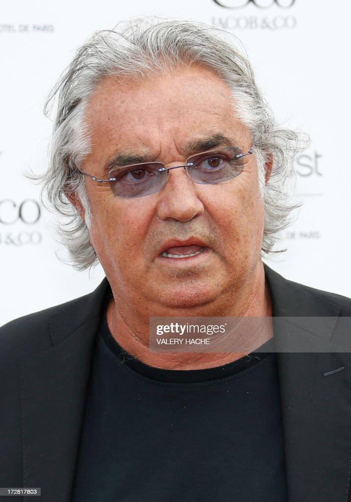 Italian celebrity Flavio Briatore poses before the 'Jacob and Co' gala on July 4, 2013, in Monaco. AFP PHOTO / VALERY HACHE