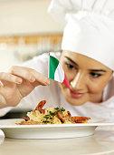Italian Chef Completing Pasta