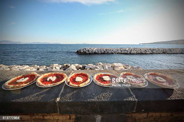 Italian chef Gino Sorbillo shows his pizza with the words 'Unesco' The art of the Neapolitan pizzamaker is to be Italy's sole contender to join...
