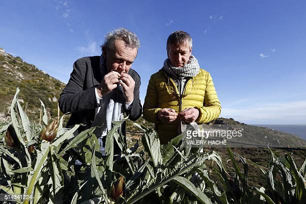 Italian chef Paolo Sari and French chef Alain Passard pose in a garden at RoquebruneCapMartin on March 8 before the '4 hands and 4 stars' diner to be...