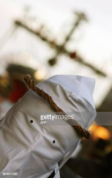 Italian Christians in long hooded robes take part in a Good Friday procession through the streets of Taranto in Puglia southern Italy on March 21...