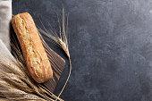 Italian ciabatta bread over stone table. Top view with copy space