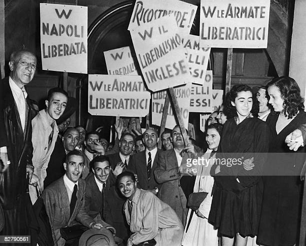 Italian civilians gathered outside the office of the Allied Military Government in Naples to cheer the announcement of their government's declaration...