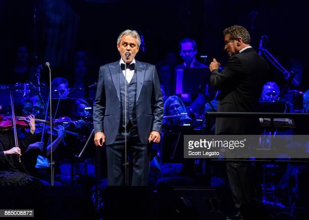 Italian classical crossover tenor recording artist and singersongwriter Andrea Bocelli and conductor Eugene Kohn perform with the Detroit Symphony...
