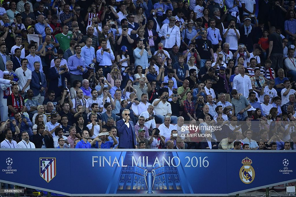 Italian classical singer Andrea Bocelli (C) performs ahead of the start of the UEFA Champions League final football match between Real Madrid and Atletico Madrid at San Siro Stadium in Milan, on May 28, 2016. / AFP / OLIVIER