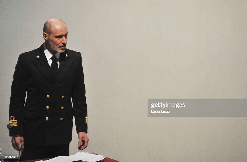 Italian Coastguard Captain Gregorio De Falco arrives at the witness stand during the hearing in the trial of the Costa Concordia on December 9, 2013 in Grosseto, Italy. Coastguard Captain Gregorio De Falco and Captain Francesco Schettino met for the first time in court today. De Falco, famous for ordering Schettino back onboard after he allegedly abandoned the ship with hundreds of passengers still onboard, took to the stand as a witness. The Costa Concordia capsized on January 13, 2012 leaving 32 people dead.