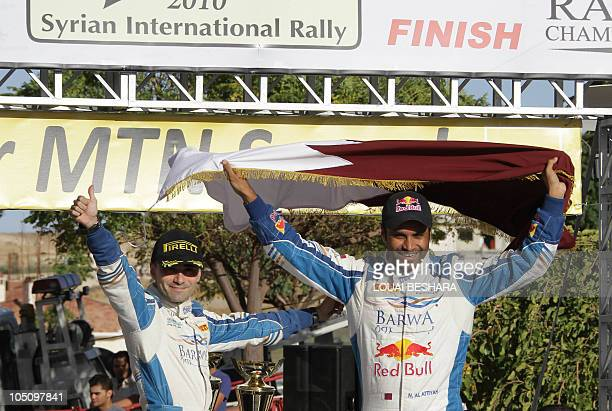 Italian Codrivers Giovanni Bernacchini and Qatar's Nasser alAttiyah celebrate their win in the 10th Syrian International Rally round six of the FIA...