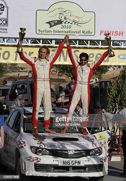 Italian codrivers Nicola Arena and Qatar's Mesfer AlMerri celebrate third position in the 10th Syrian International Rally round six of the FIA Middle...