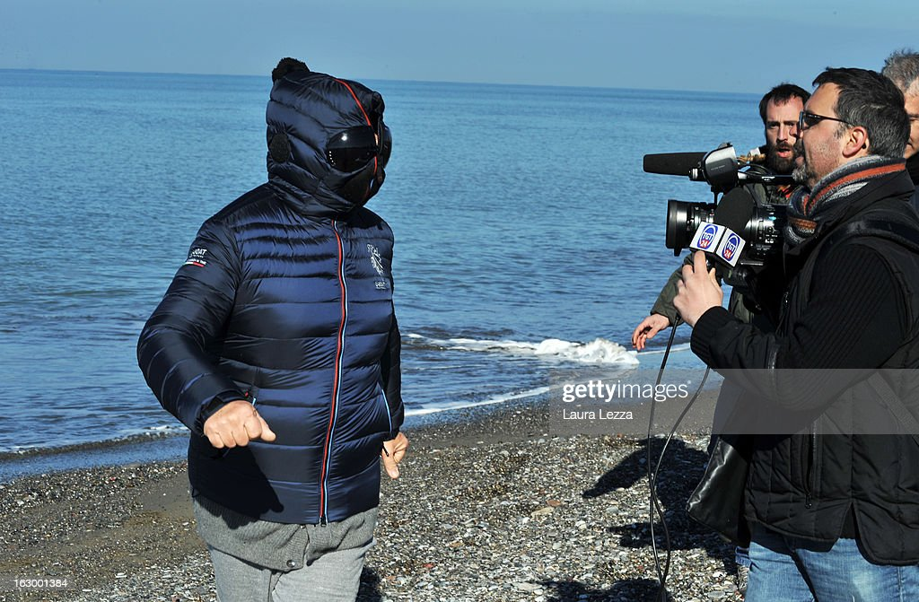 Italian comedian, blogger and political leader of the Five Stars Movement (M5S) Beppe Grillo is questioned as he runs on the beach on March 3, 2013 in Marina di Bibbona, near Livorno, Italy. Over the past two days Beppe Grillo decided to leave his house in Tuscany disguised with a mask to avoid journalists as he did not want to respond to questions about the future of his movement that will determine the future Italian politician.