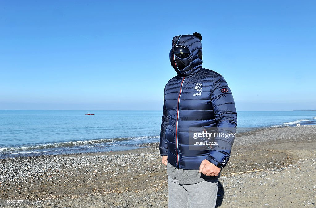 Italian comedian, blogger and political leader of the Five Stars Movement (M5S) Beppe Grillo runs on the beach on March 3, 2013 in Marina di Bibbona, near Livorno, Italy. Over the past two days Beppe Grillo decided to leave his house in Tuscany disguised with a mask to avoid journalists as he did not want to respond to questions about the future of his movement that will determine the future Italian politician.