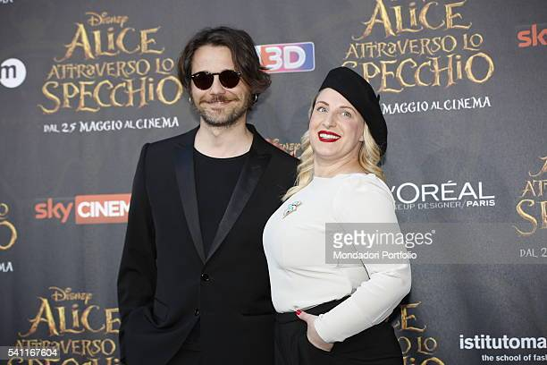 Italian comedians Angelo Pisani and Katia Follesa posing on the red carpet at the national premiere of the film 'Alice Through the Looking Glass'...