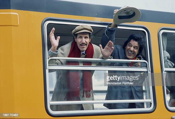 Italian comedians Franco Franchi and Ciccio Ingrassia greeting from the tram Milan 1983