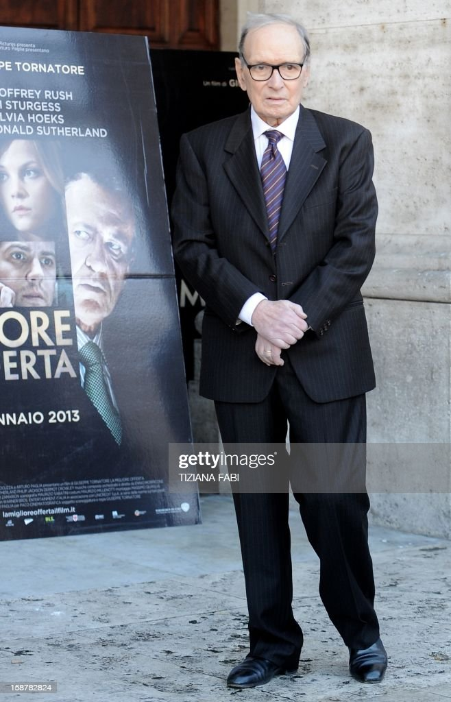 Italian composer and conductor Ennio Morricone looks on as he arrives for a projection of 'The Best Offer', a film by Italian director Giuseppe Tornatore, on December 28, 2012.