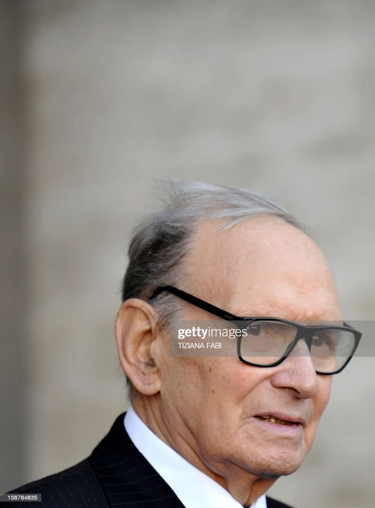 Italian composer and conductor Ennio Morricone looks on as he arrives for a projection of 'The Best Offer', a film by Italian director Giuseppe Tornatore, on December 28, 2012, in Rome. AFP PHOTO / TIZIANA FABI