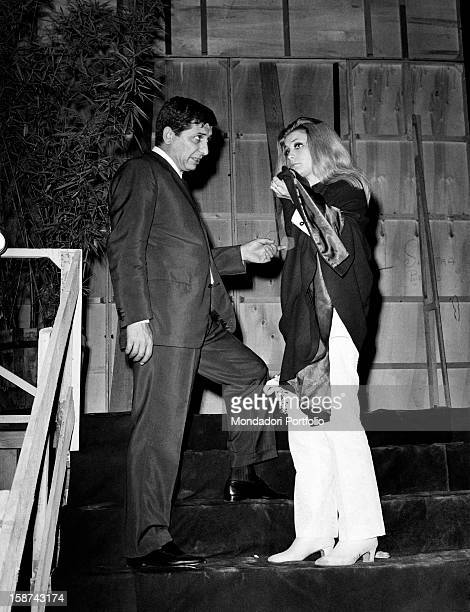 Italian composer and conductor Gigi Cichellero talking to Italian singer Patty Pravo during the Cantagiro singing show Italy 1967
