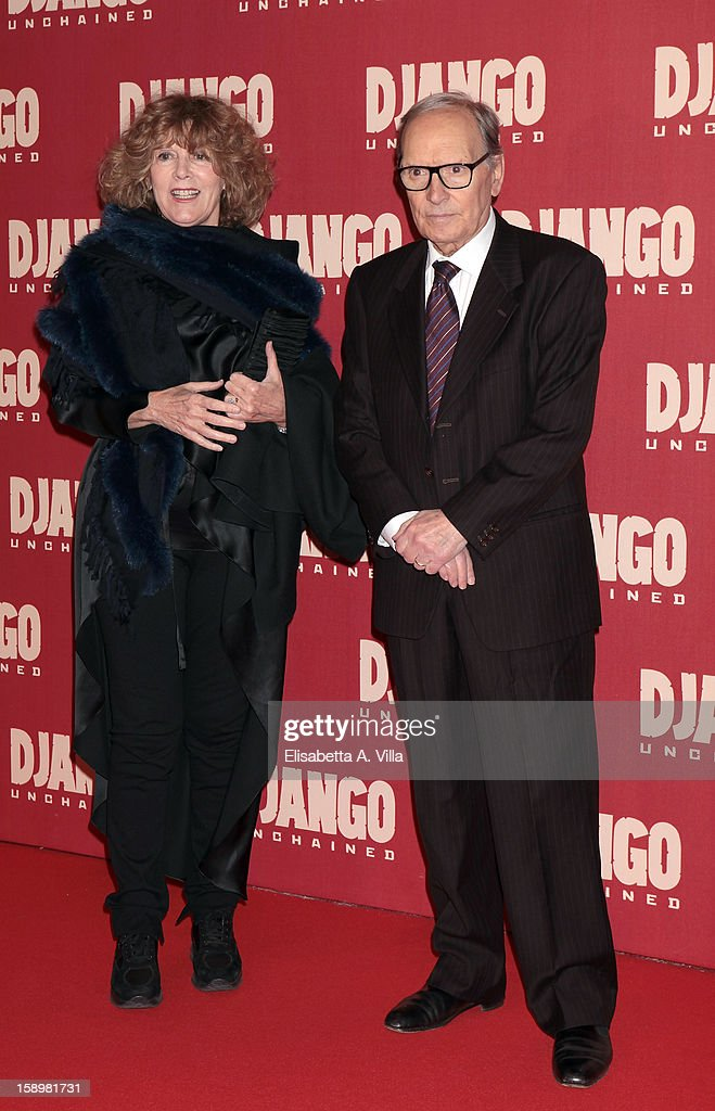 Italian composer Ennio Morricone (R) and Caterina Caselli attends 'Django Unchained' premiere at Cinema Adriano on January 4, 2013 in Rome, Italy.
