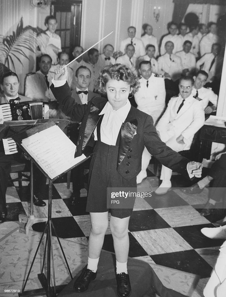Italian conductor and child prodigy Ferruccio Burco conducts the orchestra on board the liner 'SS Atlantic' 12th December 1951