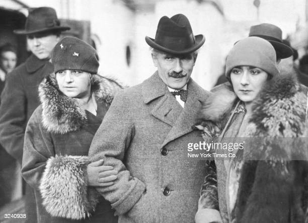 Italian conductor Arturo Toscanini with his wife and daughter Wanda right who married the pianist Vladimir Horowitz in December 1933 Both women wear...