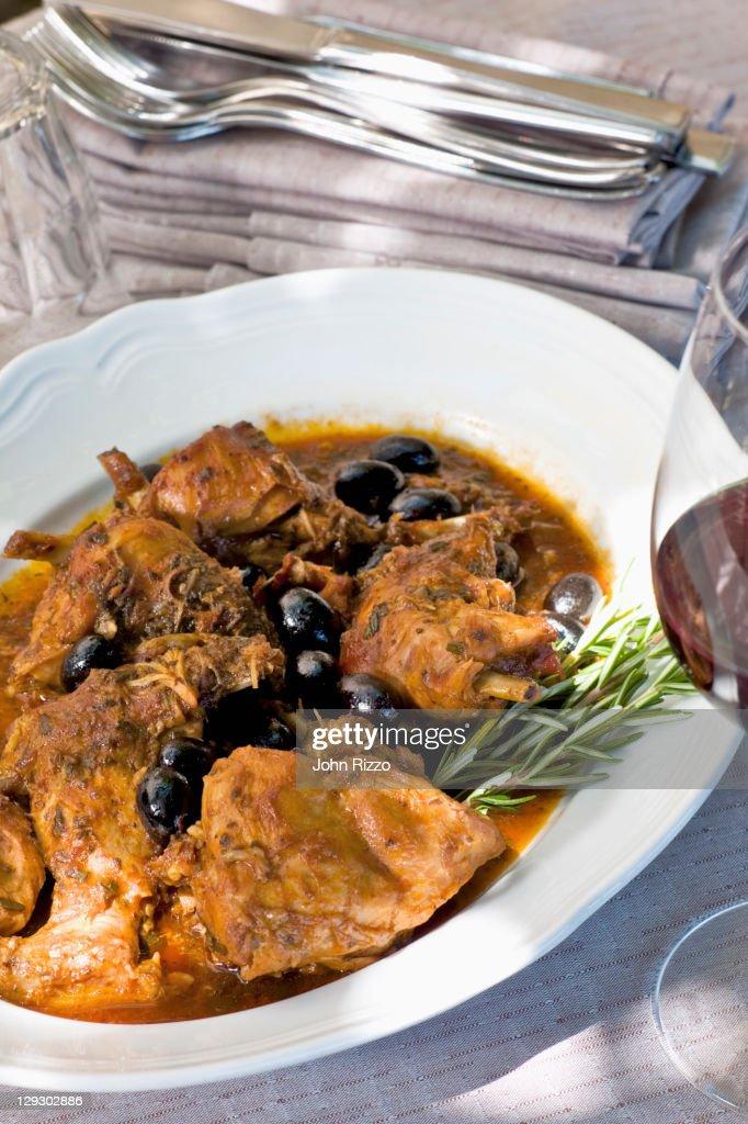 Italian coniglio e olive or rabbit and olives : Stock Photo