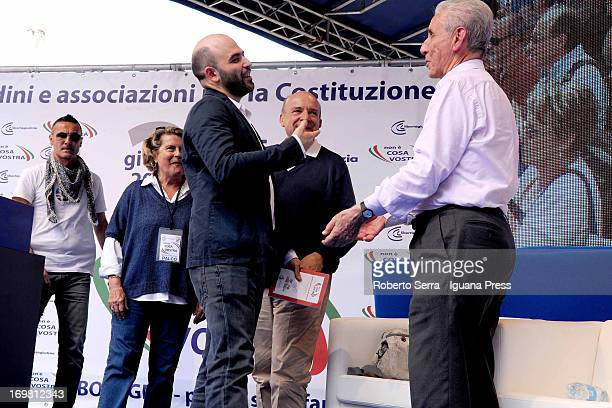 Italian constitutional lawyers Stefano Rodota and Gustavo Zagrebelsky with author Roberto Saviano attends the 'Non è Cosa Vostra' political event at...