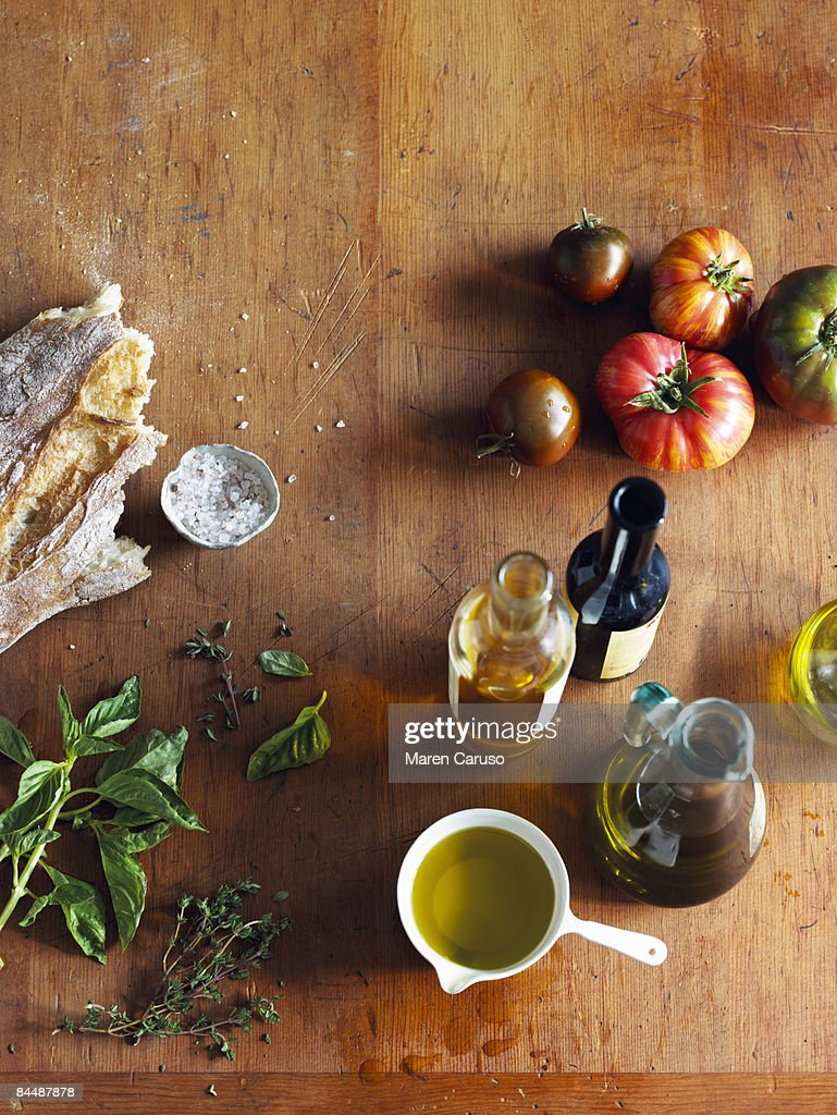 Italian cooking ingredients on a cutting board : Stock Photo